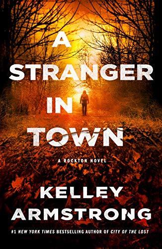 A Stranger in Town (paperback, 2021, Minotaur Books)